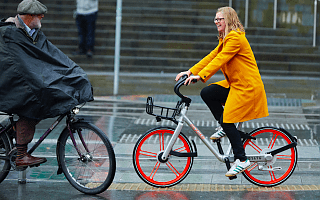 Helen Pidd riding a Mobike in the rain