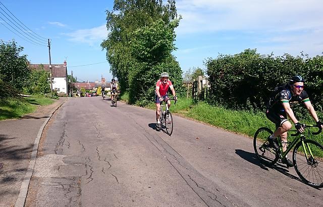 Three cyclists on club ride through Felmersham in Greast Ouse valley