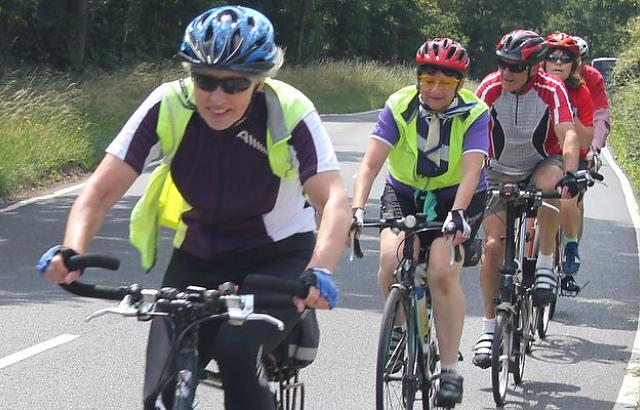 Female cyclist leading a small group