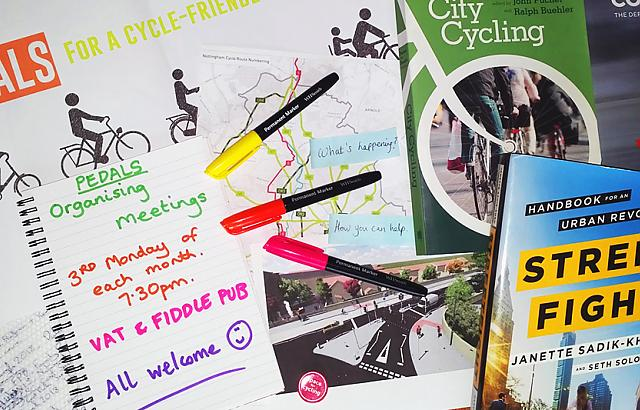 Photo of cycle campaigning books, pens and paper