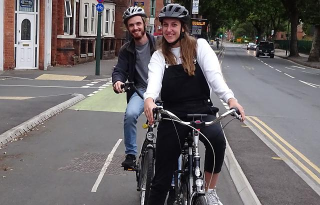Students cycling on Castle Boulevard protected cycle route in Nottingham