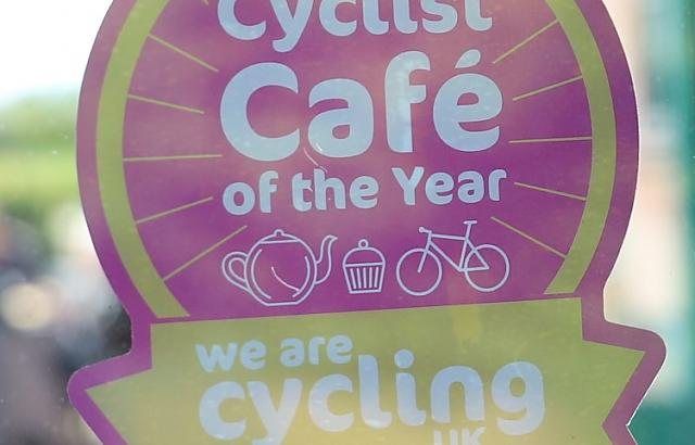 Cyclist Cafe of the Year Nominee 2020 sticker in window of Walled Garden Cafe.