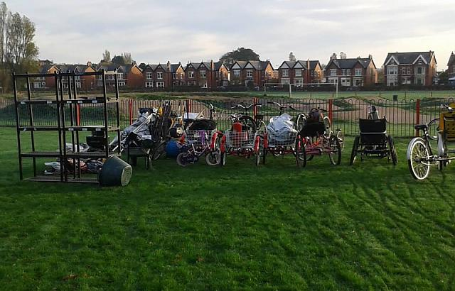 Adapted bikes sat on the grass