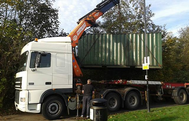 Removal of the old container with a Hiab