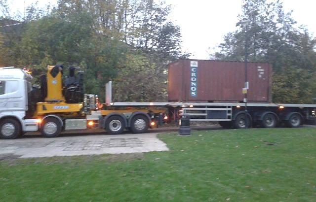 The new container being transported to site
