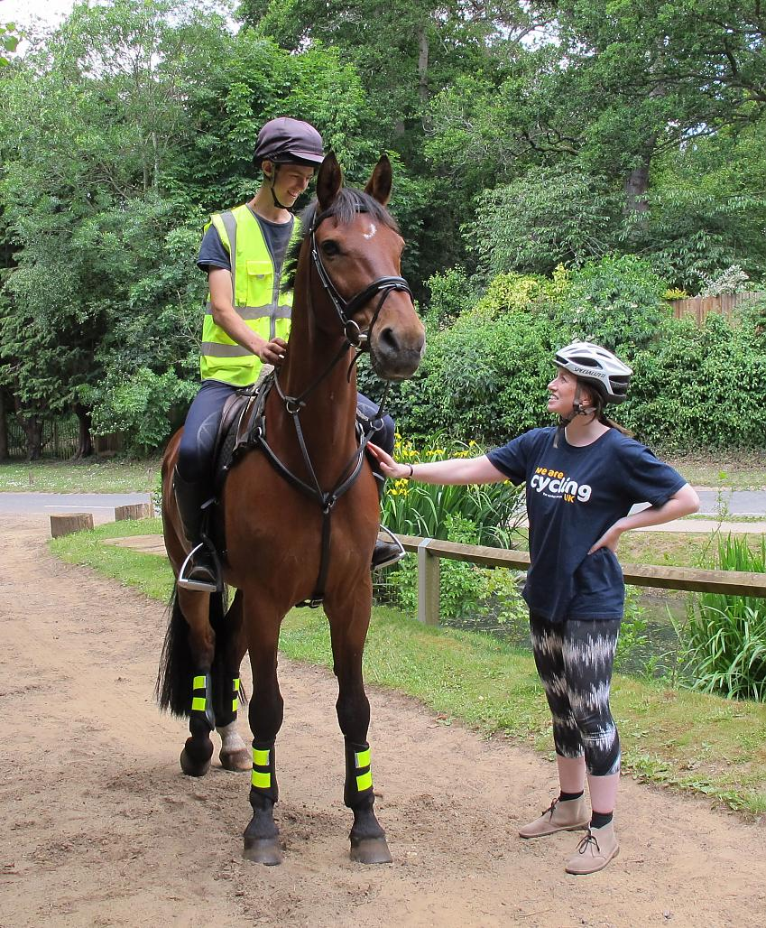 Cyclist meeting a horse