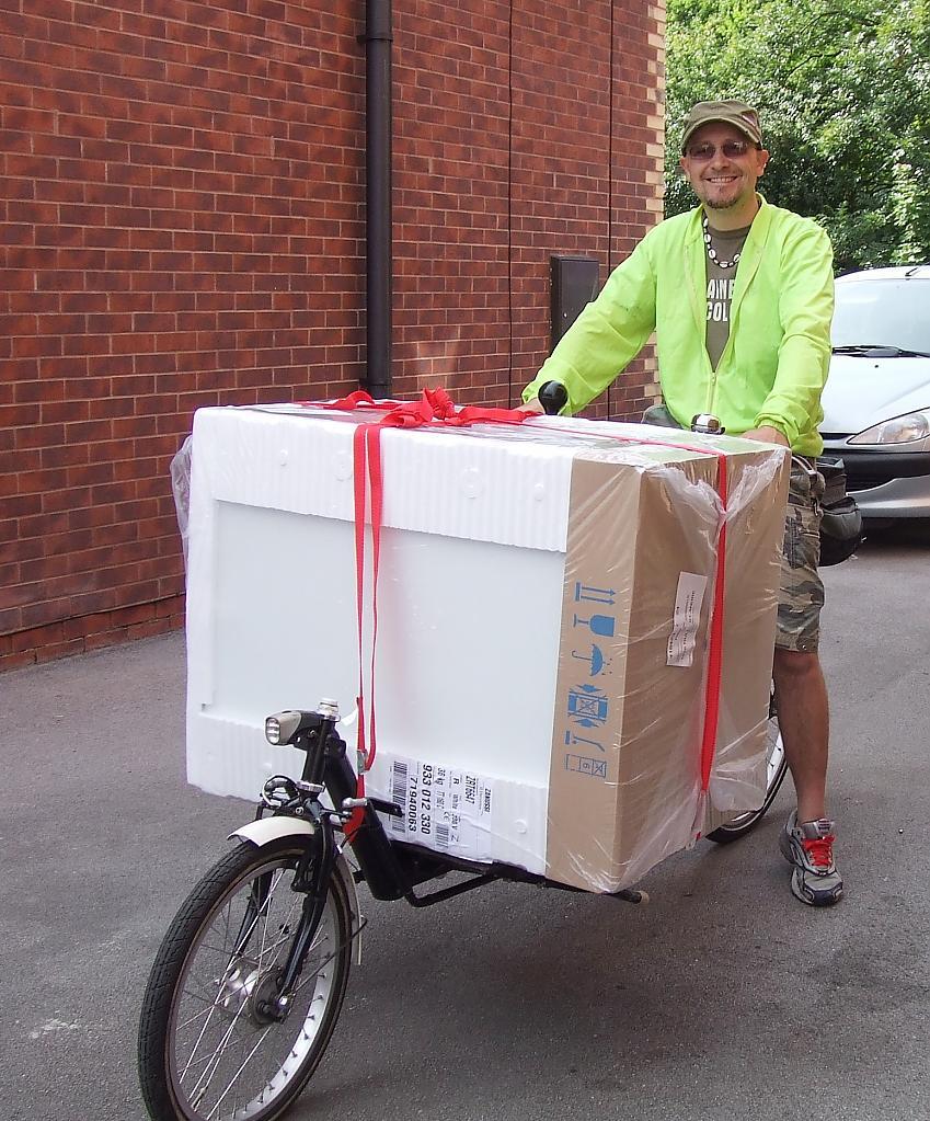 A man with a laden e-cargo bike
