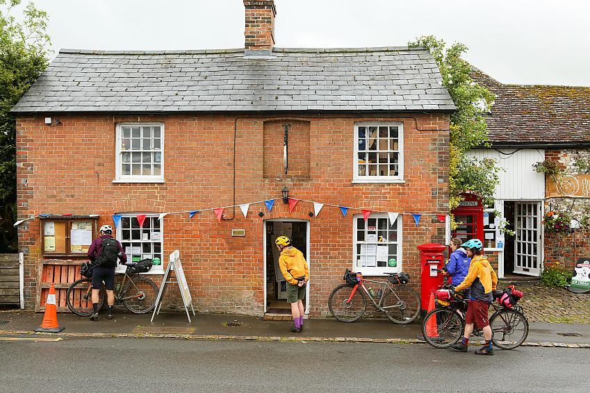 Cyclists outside of a shop