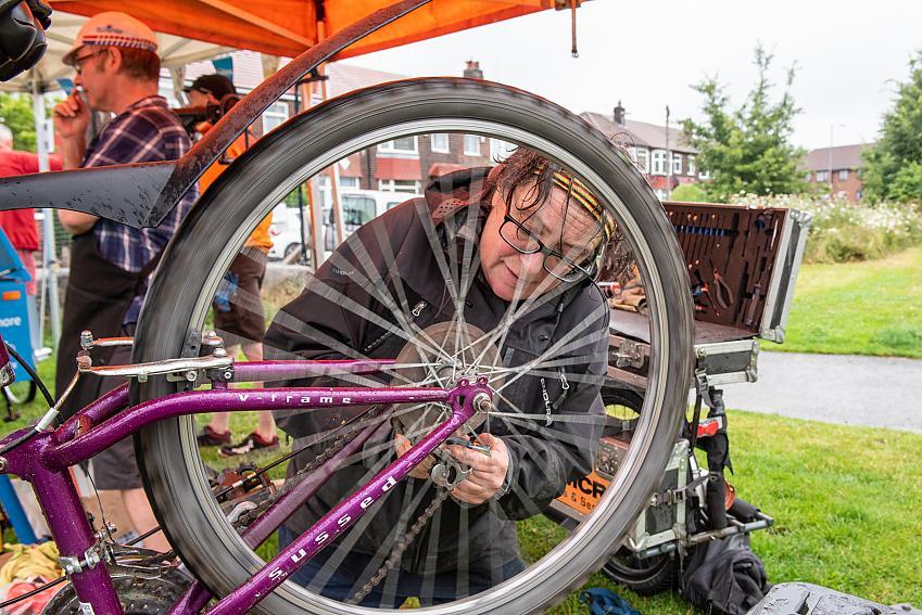 A bike mechanic fixes a bike
