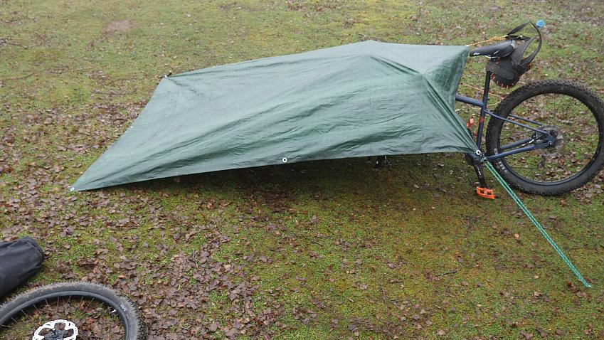 A tarp set up using a bike frame