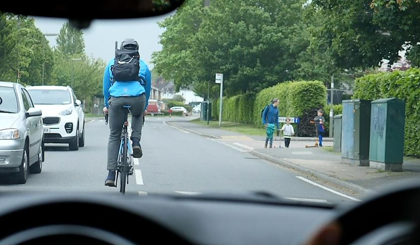 Cyclist riding out from the car-door zone