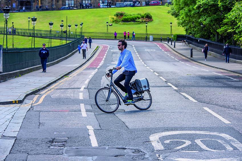 A cyclist riding in a 20mph zone in Edinburgh