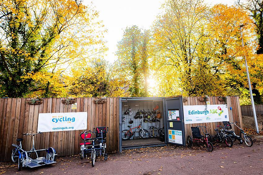 A range of adaptive bikes parked outside the Edinburgh ABC base in Saughton Park