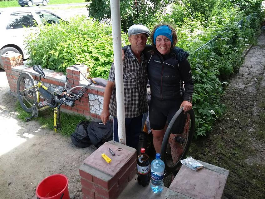 Jenny Graham with a friendly man she met while fixing a puncture in eastern Russia