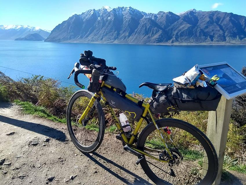 Jenny Graham's bike with spectacular New Zealand lake and mountains in background