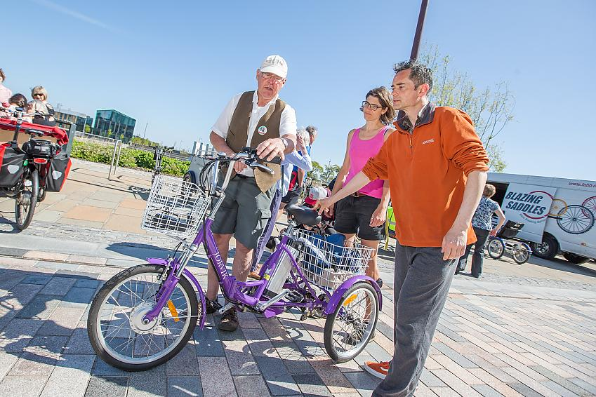 Ian and others standing around an e-trike