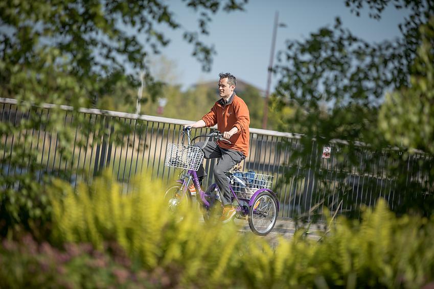 Ian Tallach riding an electric trike