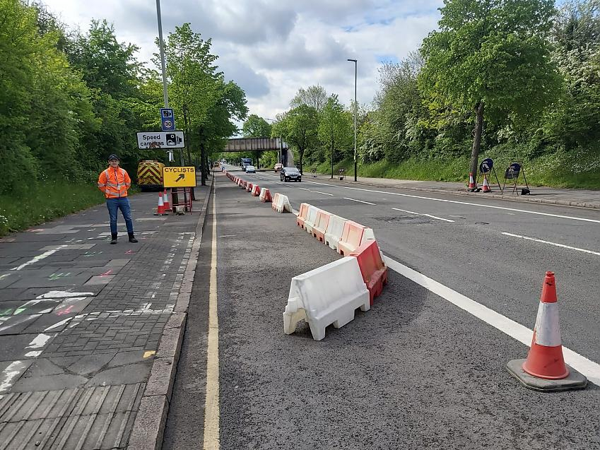 Barriers creating temporary cycle lane