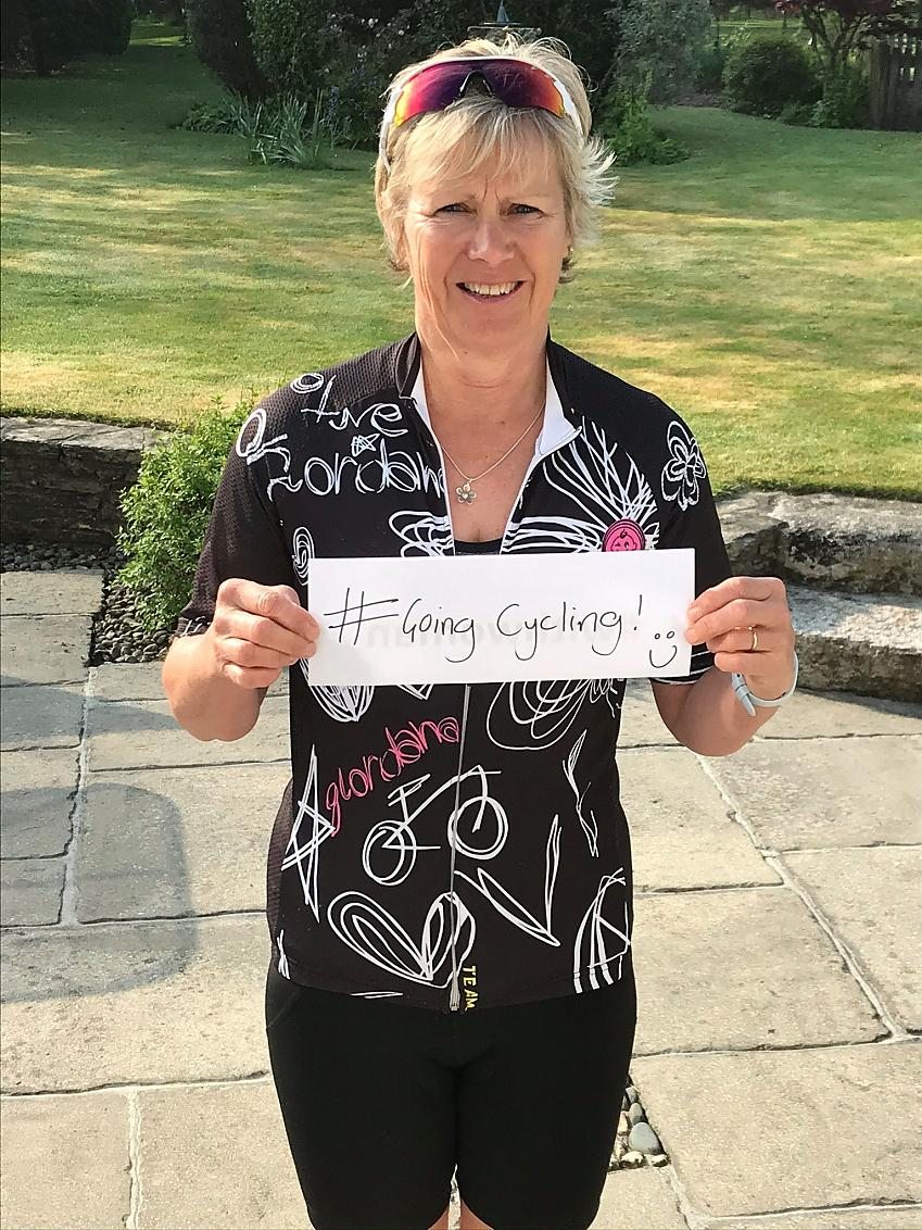 Judy Baker holding #GoingCycling sign