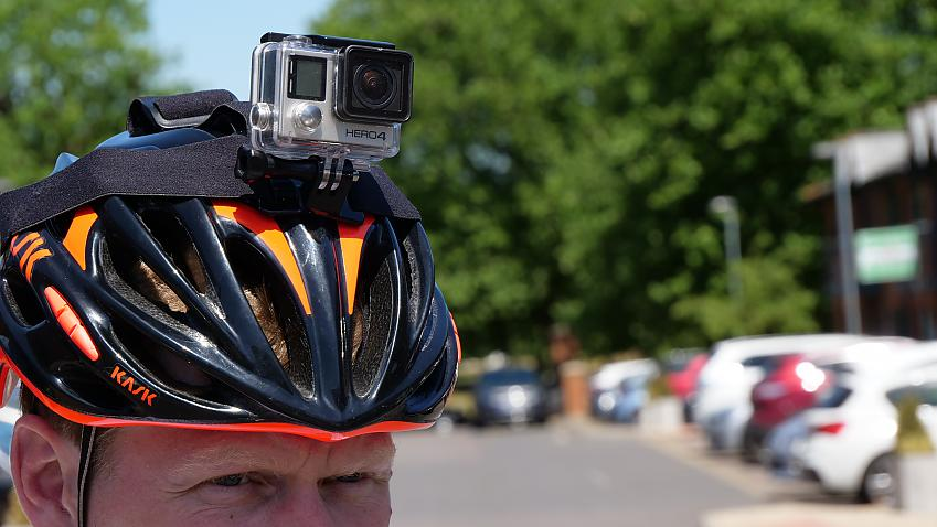 Close up of cyclist wearing a helmet with a headcam