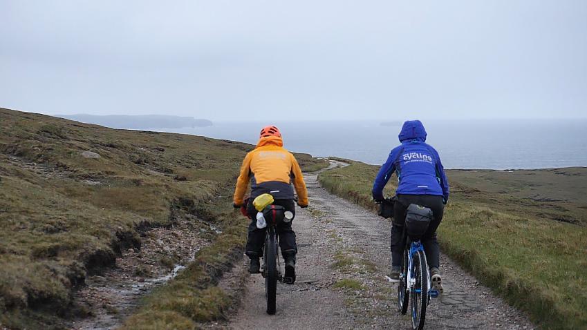 Two bikepackers off-road