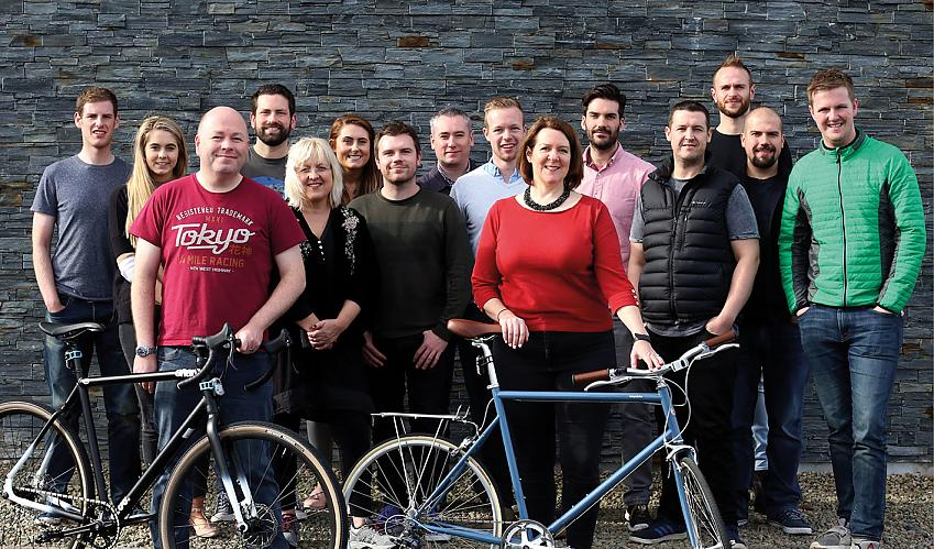 Founders Phillip and Irene McAleese (with bikes) with the See.Sense team.