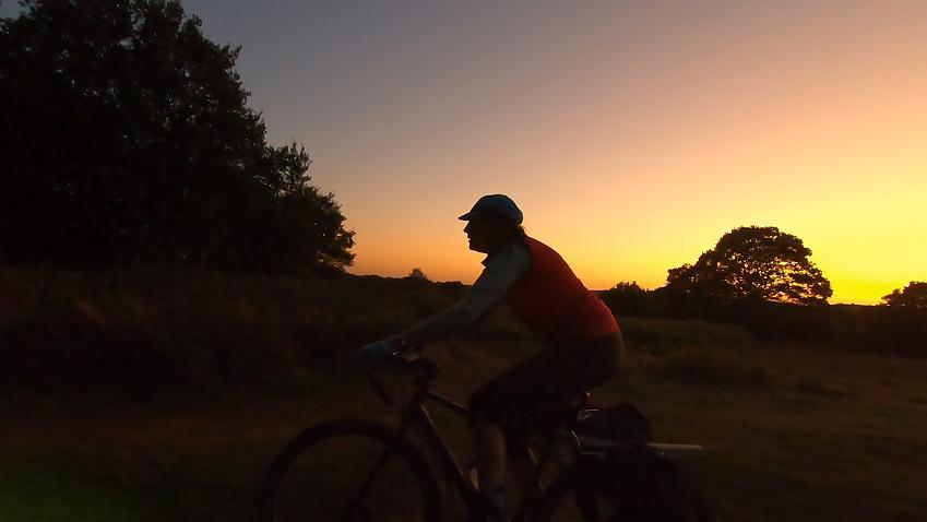 Cyclist heading off into the dusk