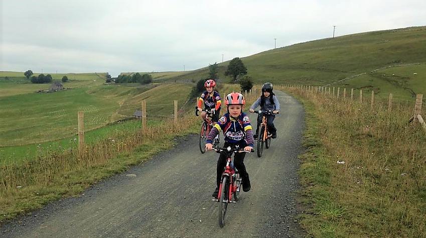 Children cycling on traffic-free trail