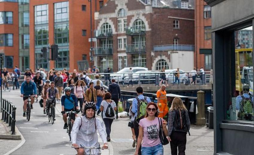 Cyclists on Baldwin Street in Bristol