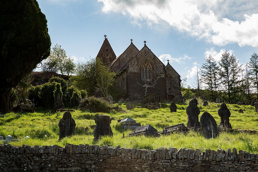 Church with gravestones in front