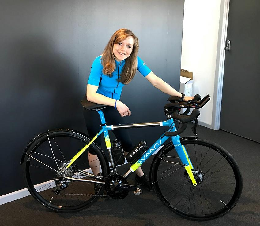 Alaina collects her new bike.