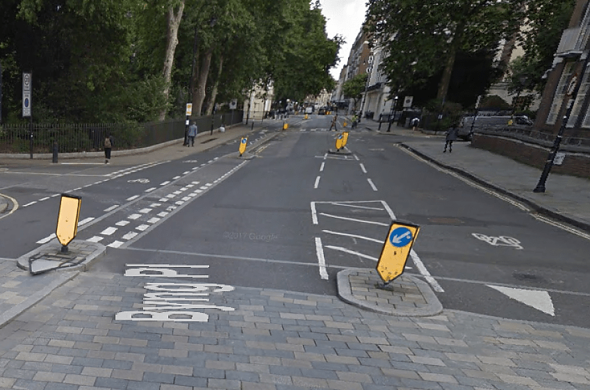 Give-way line for drivers turning into a side road, Torrington Place, London - but it doesn't conform to UK signing rules!
