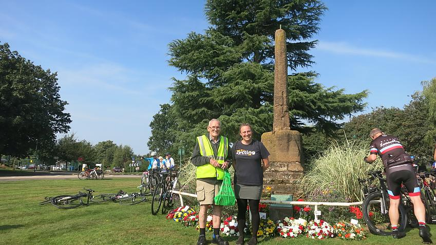 John Sullivan and Christina Bengston standing in front of the monument commemorating Meriden as the traditional centre of England