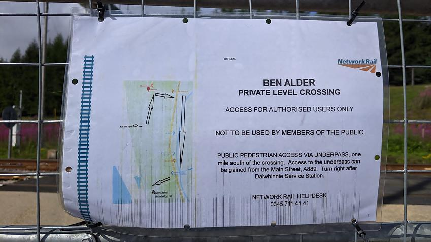 A notice attached to the gates of the level crossing stating there is no public access