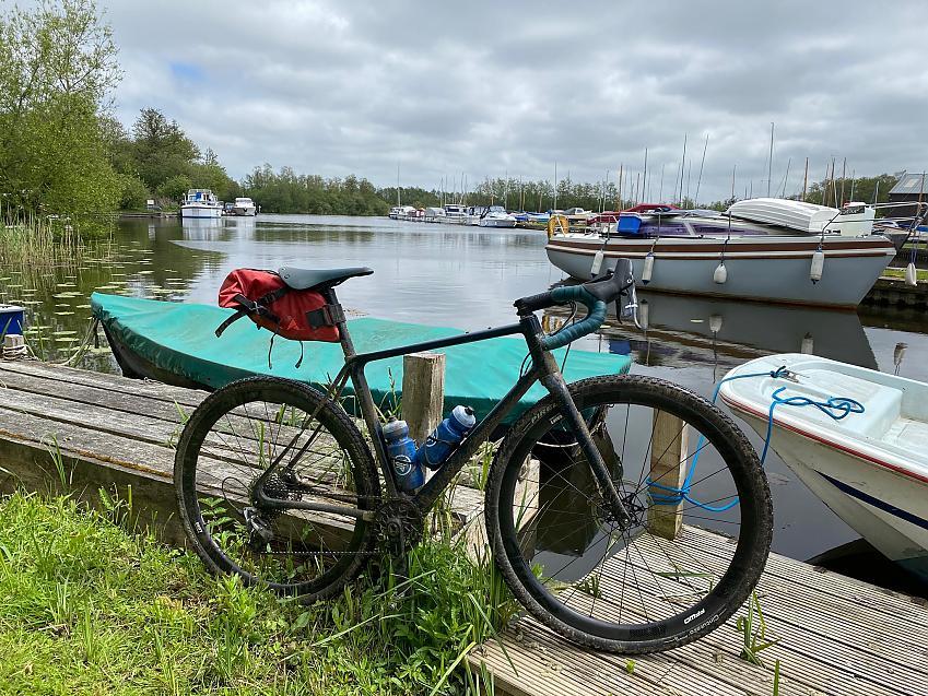 Bike and moored boats