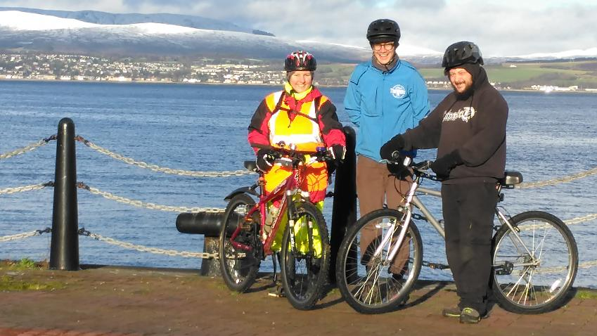 Chris with his bike on a Better Biking session with two others