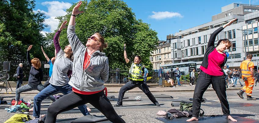 People doing yoga in the street