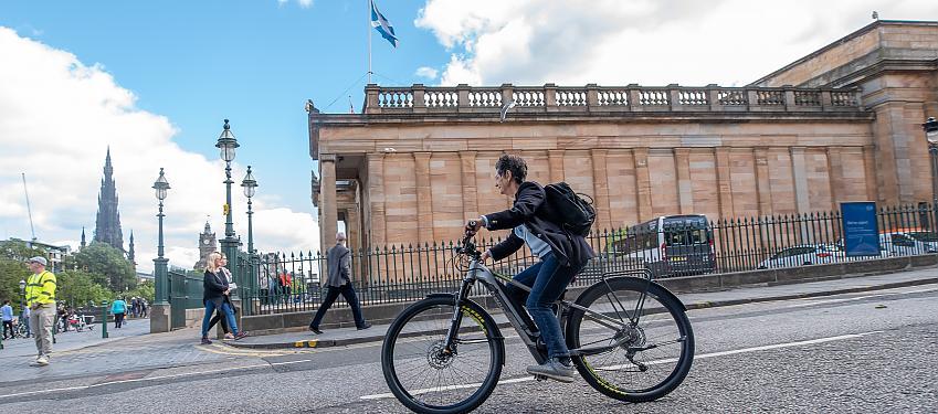 Woman riding an e-bike in Edinburgh