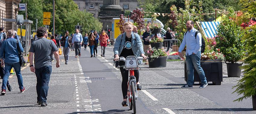Girl cycling in Edinburgh