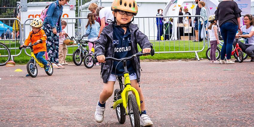 Young child on balance bike