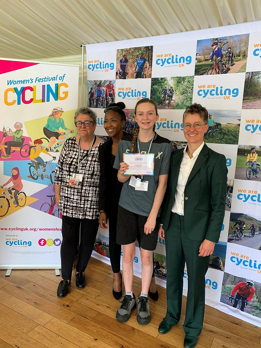 Eme at the House of Parliament, receiving her Cycling UK 100 Women in Cycling award for 2019