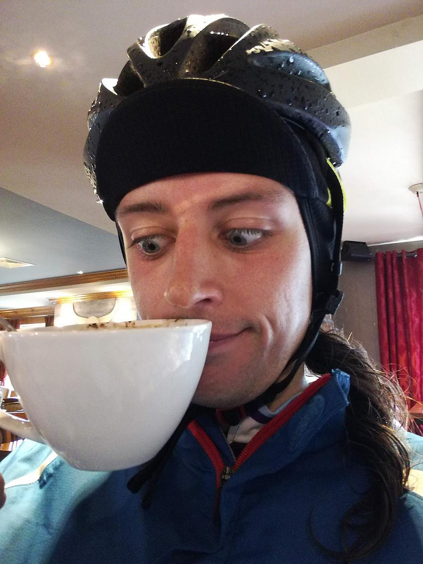 Esmond looking lovingly at a cup of coffee