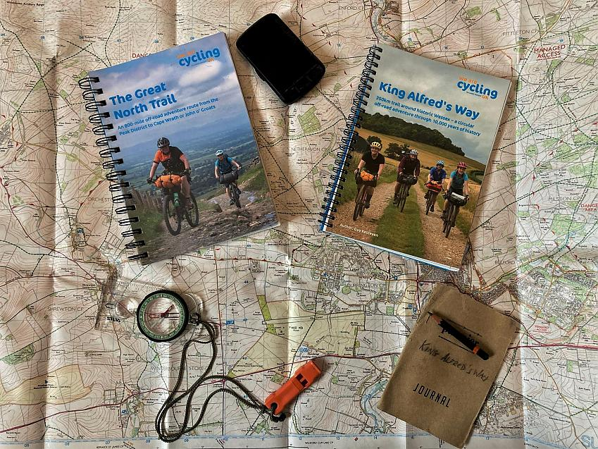 Guidebooks for the Great North Trail and King Alfred's Way rest on a map