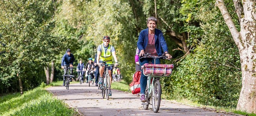 People cycling along a traffic free path