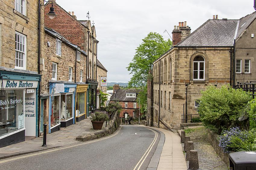 Stone buildings lining a steep town street