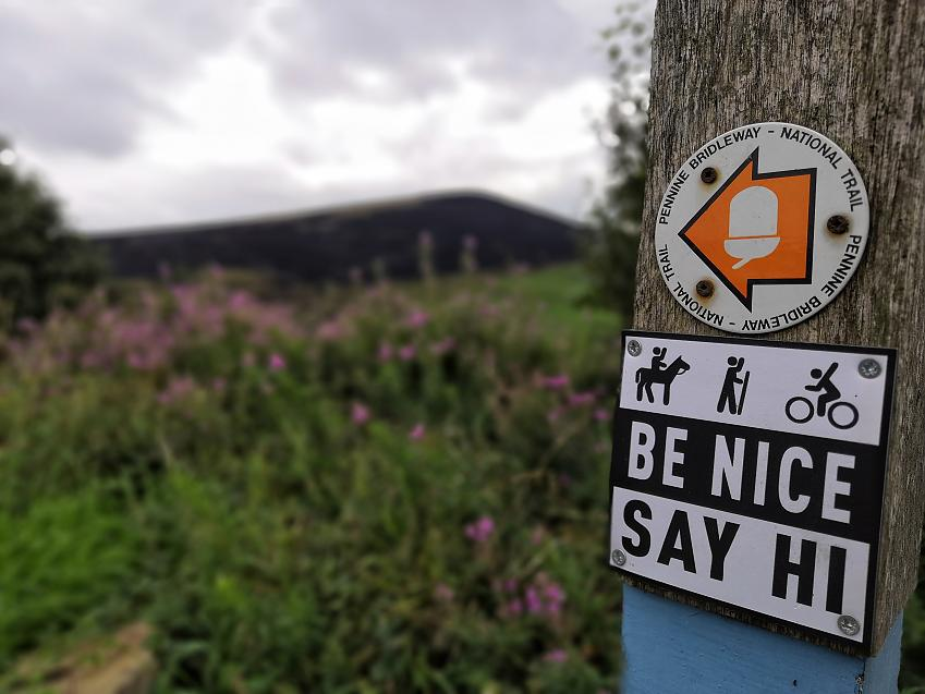 Be Nice Say Hi sign in use on Pennine Bridleway