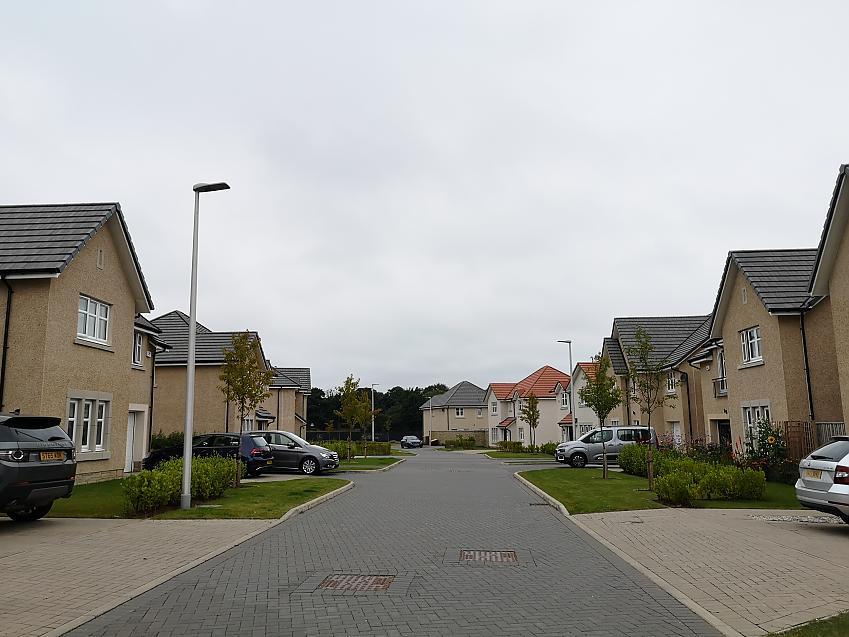modern housing development with no pavement