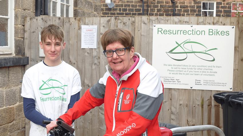 Janet with Resurrection Bikes volunteer William