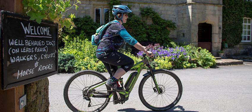 Woman riding an e-bike