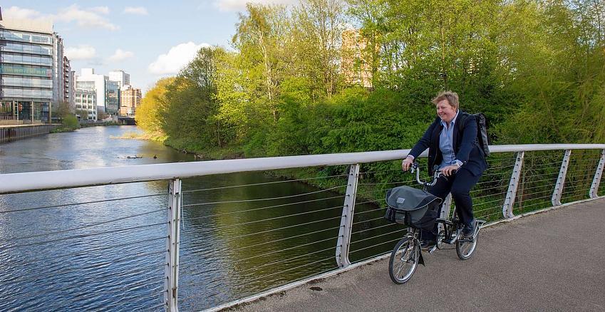 Lady cycling over bridge